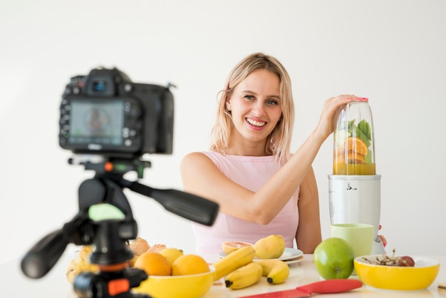 Blonde influencer recording nutrition food Free Photo