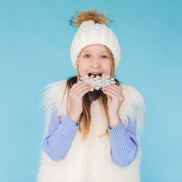 Blonde little girl eating a snowflake Free Photo