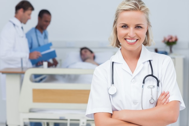 blonde nurse crossing her arms photo premium download