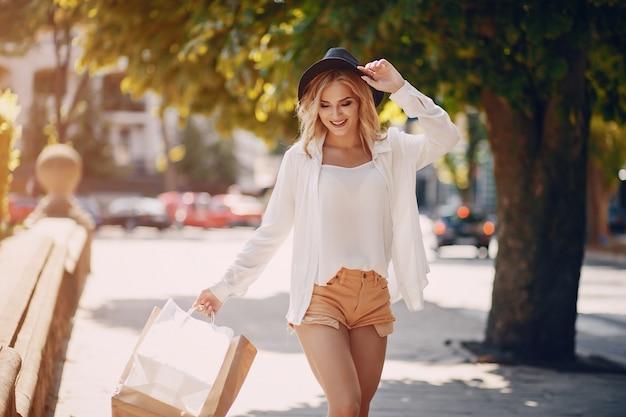 Blonde at shopping Free Photo