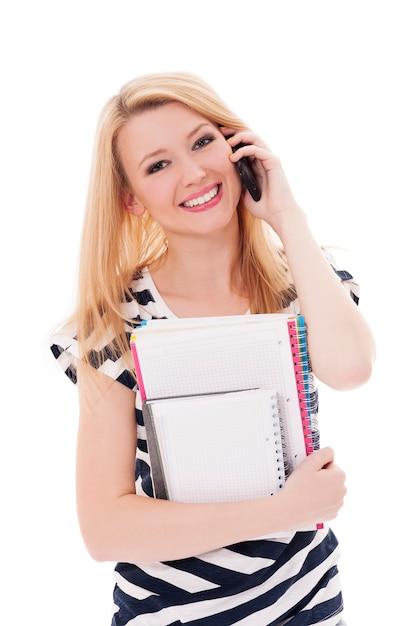 携帯電話を持つ金髪の学生 無料写真