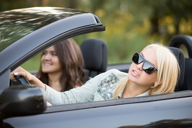 Blonde teen driving her convertible Free Photo