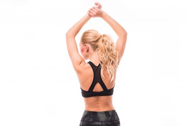 長い髪のブロンドは白で隔離される彼女の背中にスポーツを行う 無料写真