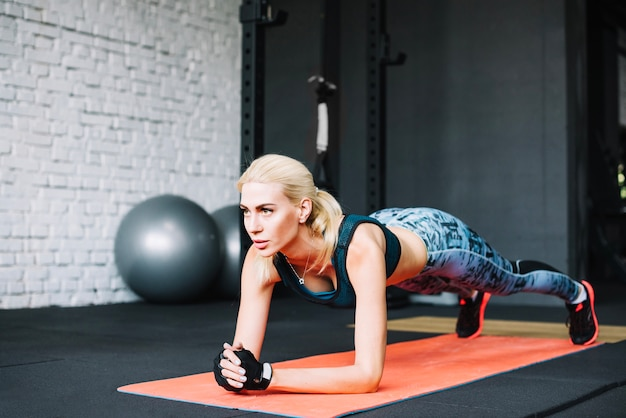 Blonde woman doing plank exercise Free Photo