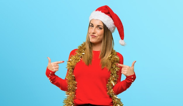 Blonde woman dressed up for christmas holidays proud and self-satisfied in love yourself Premium Photo