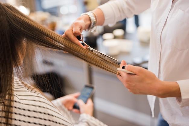 Blonde woman getting her hair cut Free Photo