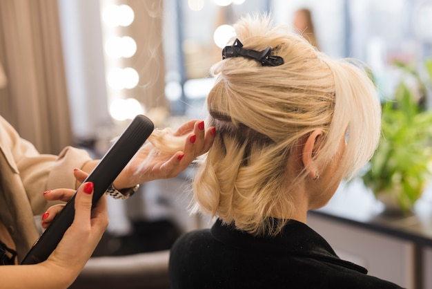 Blonde woman getting her hair done Free Photo