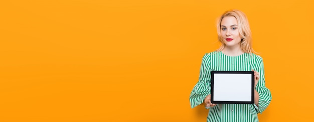 Blonde woman holding tablet computer Premium Photo