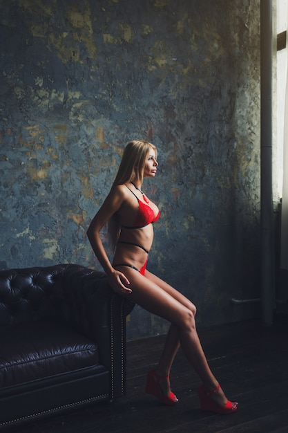 Blonde woman posing in sexy red Premium Photo