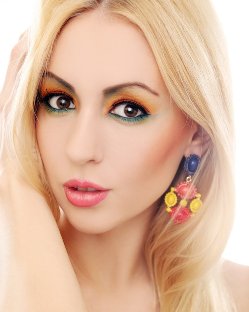 Blonde woman showing her cute colored look Free Photo