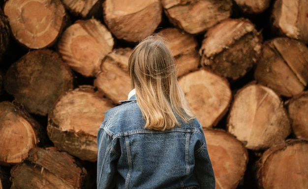 Blonde woman standing near lumbers during daytime Free Photo