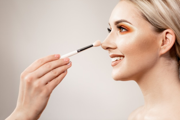 Blonde Woman With Bright Makeup