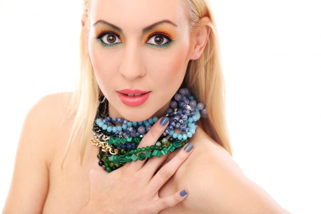Blonde woman with necklace showing her cute colored look Free Photo