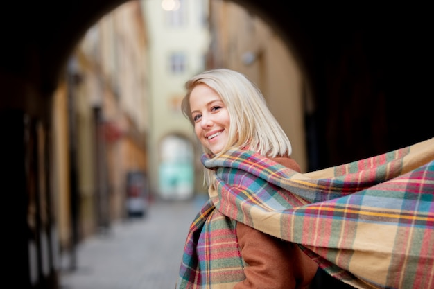 Blonde woman with scarf in old town of wroclaw Premium Photo