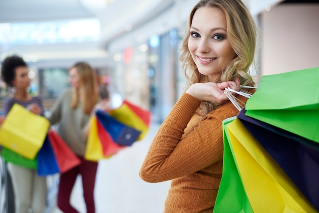 Blonde woman with shopping bags Free Photo
