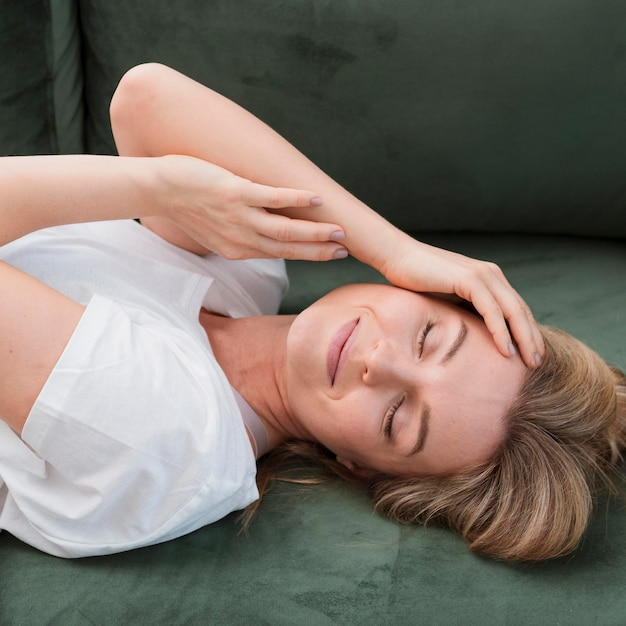Blonde young woman resting her eyes Free Photo