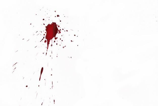 Blood splatters on white background Premium Photo
