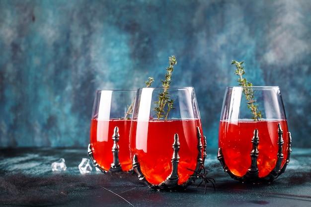 Bloody halloween party cocktail Premium Photo