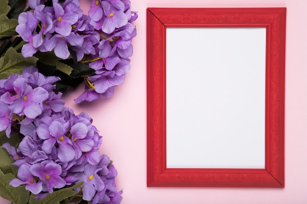 Blooming flowers beside frame Free Photo