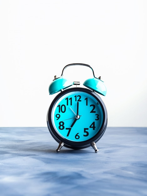 Blue alarm clock on abstract background Premium Photo