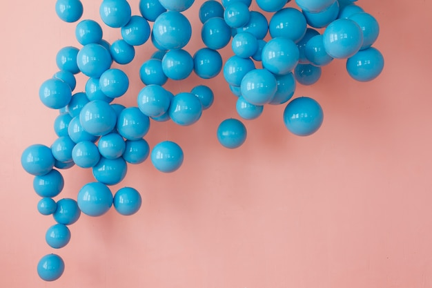 Blue balloons, blue bubbles on pink background. modern punchy pastel colors Free Photo