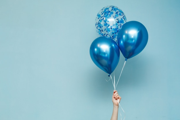Blue birthday balloons with copy space for text. Premium Photo
