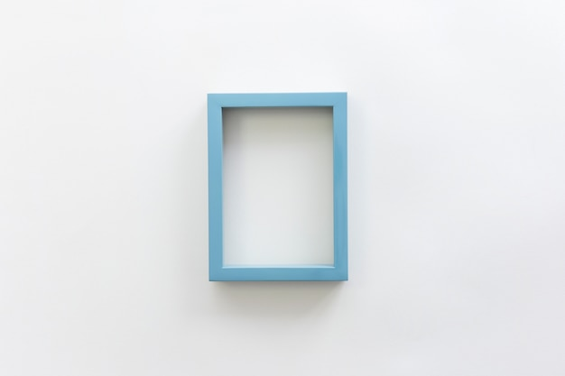 Blue border empty blank picture frame against white backdrop Free Photo