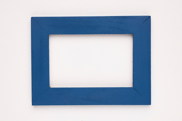 Blue border frame on white backdrop Free Photo