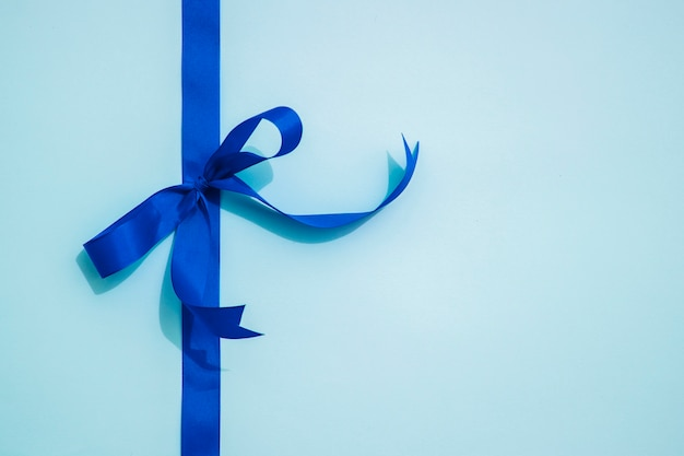 Blue bow ribbon and copy space Free Photo