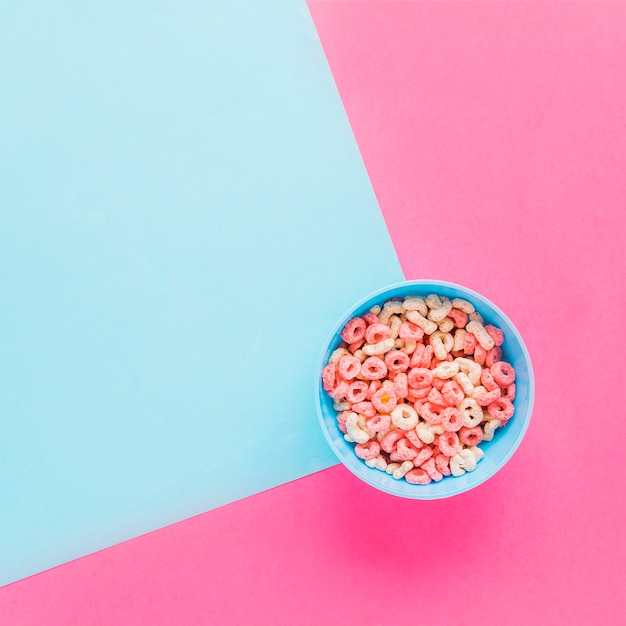 Blue bowl with cereal on table Free Photo