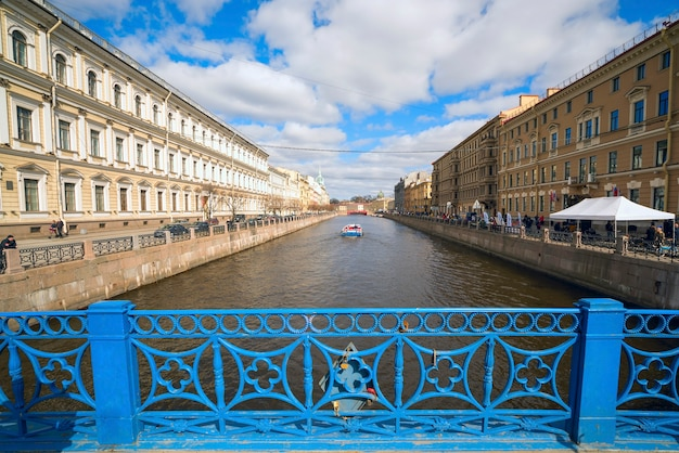 Blue bridge over the moika river in st. petersburg, russia. Premium Photo