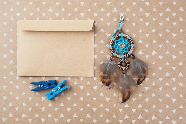Blue brown dream catcher and kraft envelope Premium Photo