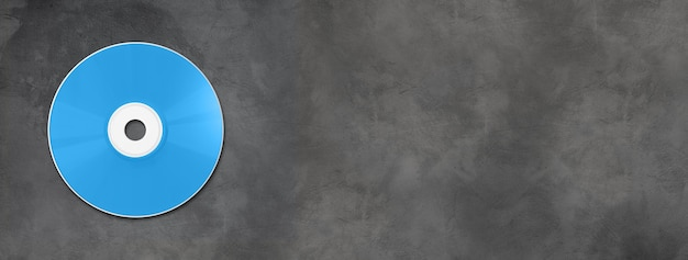 Blue cd - dvd label mockup template isolated on horizontal concrete banner Premium Photo