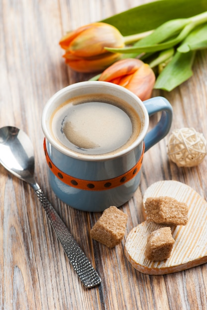 Blue ceramic cup of black hot coffee with brown sugar Premium Photo