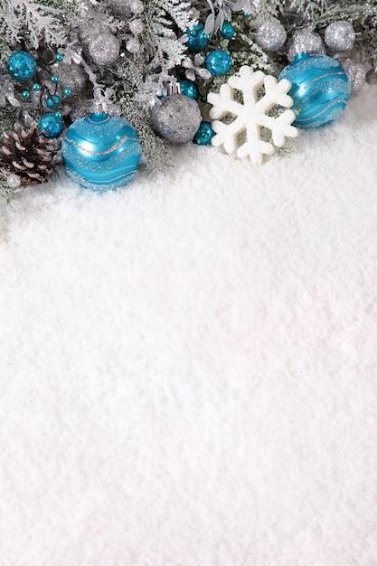 Blue christmas balls and snowflake Free Photo