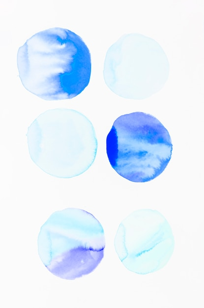 Blue circle pattern made with watercolor brush stroke Free Photo
