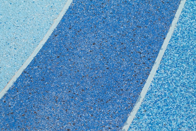 Blue color tone of terrazzo floor out door lane for exercise