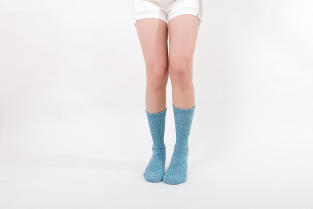 Blue cotton socks on beautiful woman's feet  isolated on white