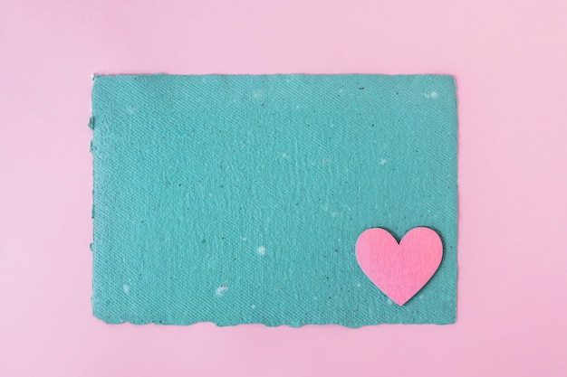Blue craft paper and decorative heart Free Photo