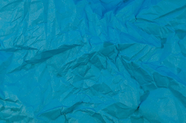 Blue crumpled paper texture Free Photo