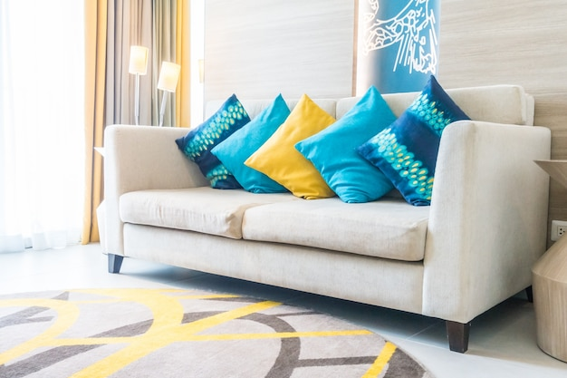 Blue cushions and one yellow cushion Free Photo