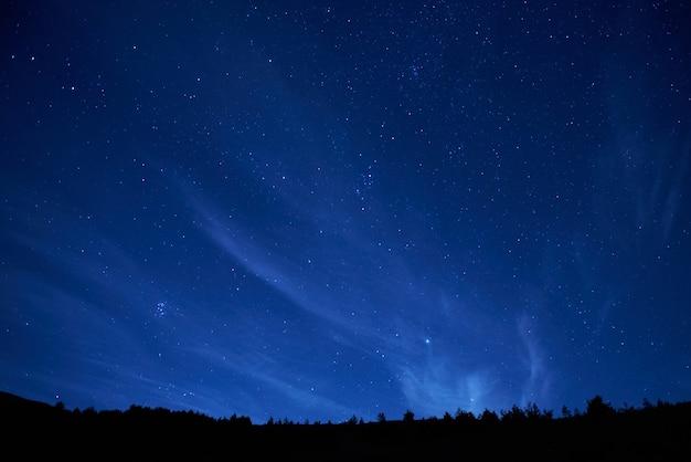 Blue dark night sky with many stars. space background Premium Photo