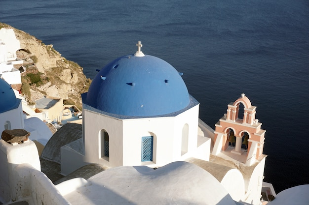 Blue dome church in oia, santorini, greece Premium Photo