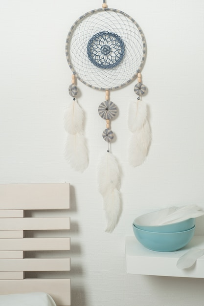 Blue dream catcher with white feathers Premium Photo
