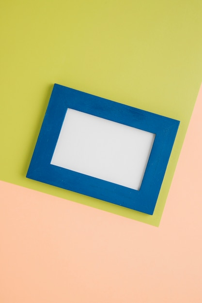 Blue empty frame on bicolor background Free Photo