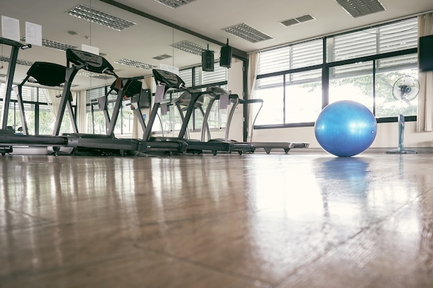 The blue exercise ball placed in the center of the fitness room Premium Photo