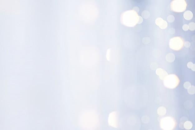 Blue fabric with bokeh light reflex blur background Premium Photo