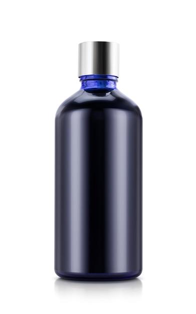 Синяя стеклянная бутылка с серебряным колпачком для дизайна косметического изделия бизнесмена Premium Фотографии