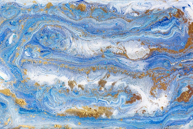 Blue and gold marbling. golden marble liquid texture. Premium Photo