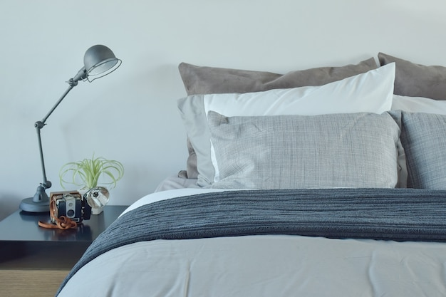 Blue and gray color scheme bedding with industrial style table lamp Premium Photo